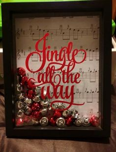 """Jingle all the way"" shadow box w music sheet as back drop."