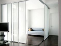 Using frosted glass doors divides a large space without blocking light from the windows.