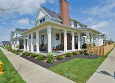 Great wraparound porch! A Sugarberry Cottage Built in Kentucky - Hooked on Houses
