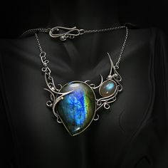 UXULH - silver ,labradorite , topaz by LUNARIEEN necklace jewelry pendant amulet clothes clothing fashion cosplay costume LARP equipment gear magic item | Create your own roleplaying game material w/ RPG Bard: www.rpgbard.com | Writing inspiration for Dungeons and Dragons DND D&D Pathfinder PFRPG Warhammer 40k Star Wars Shadowrun Call of Cthulhu Lord of the Rings LoTR + d20 fantasy science fiction scifi horror design | Not Trusty Sword art: click artwork for source