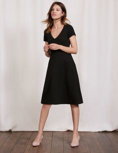 Illusion is the key with this clever dress. Panels of rich waffle jacquard and a flared skirt combine to fit and flatter your shape. Finishing at the knee, our design is sophisticated while being a little cheeky too. This dress will take you from chairing board meetings to champagne receptions.