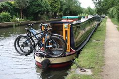 We did not want to have the bikes lying on the roof of the boat, not only does it look messy it's not good for either the boat or the bikes. Also there is every chance that a careless rope ca… Barge Boat, Canal Barge, Canal Boat, Barge Interior, Narrowboat Interiors, Boat Storage, Boat Projects, Floating House, Boat Stuff