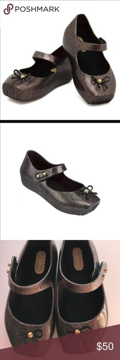 Mini Melissa Mary Jane's / Ballet flats. Black with Multi glitter. Mini Melissa puts a little sparkle in her step with these glittery mary janes. velcro strap closure with gold-tone button detail at side, and bow detail on front, square toe, all mini melissa shoes are infused with a signature fragrance rubber. Mini Melissa Shoes Dress Shoes