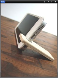 iPhone stand (make two and would also work for an iPad). Plywood with felt lining.:                                                                                                                                                                                 More