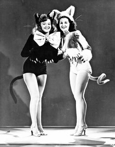 cat dancers in Lady of Burlesque (1943). good inspiration for costumes, i especially like the giant bow. if the suits are velvet, it'd add more texture too...