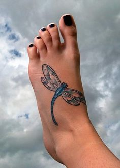 Big dragonfly tattoo on foot for young ladies.