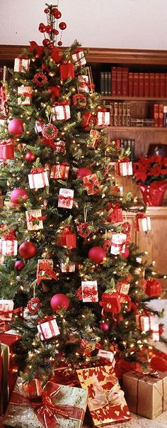 Red and white Christmas tree...   ***I like the little gift boxes decorating the tree -- different!***