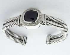 Sterling Silver double cable bracelet with faceted black onyx and pave Cubic Zirconium.