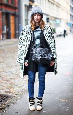 We're loving boldly patterned coats (and a furry pom pom hat) #streetstyle