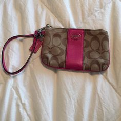 Coach wristlet Sweet Coach wristlet. In signature brown print with hot pink leather accents. Super cute for date night or heading to the mall with the girls. Pristine condition. Used for only a couple of weeks if that. Perfect as a gift!! Coach Bags Clutches & Wristlets
