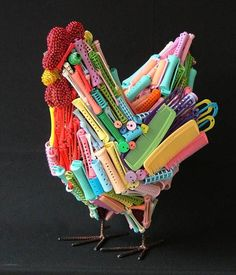 Plastic comb/curlers etc. chicken sculpture. AMAZING