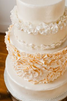 Cream and ivory #weddingcake with ruffle detailing | Ivy & Stone Photography | see more on: http://burnettsboards.com/2014/04/classically-romantic-wedding/