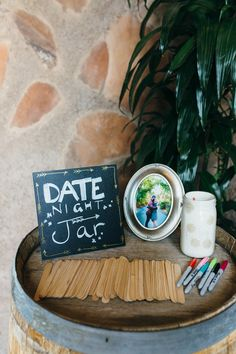 Wedding guestbook-alternative idea - popsicle sticks for guests to write date ideas {Suzy Goodrick Photography}