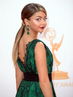 901 Girl  Sarah Hyland pulled back her rich ombre locks into a low wrapped ponytail and complemented her jewel-toned gown with a dark oxblood lip.