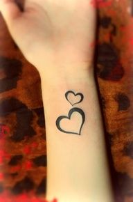 heart tattoos for girls on wrist... but in white?