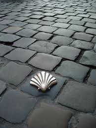 Scallop shell emblem on cobbles - Camino Santiago