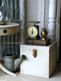 Vintage vignette with scale, book and galvanized watering can