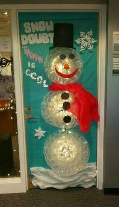 door decoration contest snowman made with clear plastic cups with strand of lights behind them