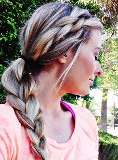Who says you can't be cute while being active? Try this braided hairstyle for your next workout session.