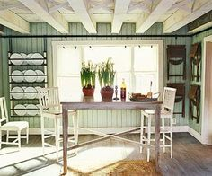 European Cottage Style: Swedish Elegance and Modern Sparseness - cover walls with tongue-and-groove wood, add Scandinavian-style woodburning stove with tile behind it, lay wide plank hardwood floors and give them a natural scrubbed finish.  Use soft grayed colors, such as chalky blues and greens to keep the Swedish mood.  Add in rustic colors like rust and oatmeal.  Whitewash over natural woods.