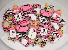 Shower cookie idea 2&3 of 10: rattles or bottles, and cheetah print monogram