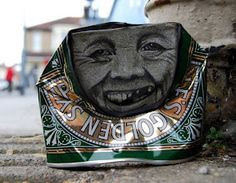 ARTIST PAINTS FACES ON CANS FOUND LITTERED ON THE STREET mymodernmet.com