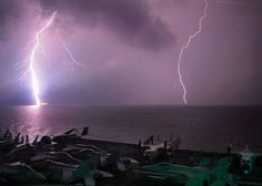 Lighting flashes as the aircraft carrier USS Abraham Lincoln (CVN 72) transits the Strait of  Malacca (October 8, 2010).