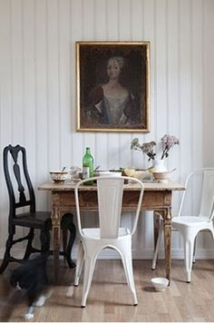 We covet Original Tolix chairs paired back with antique timber tables. Image Via: Habitually Chic