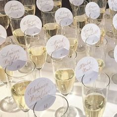 Champagne escort cards in calligraphy                                                                                                                                                     More