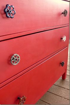 Clever use of vintage water valves as pulls on a dresser, or hanging knobs.
