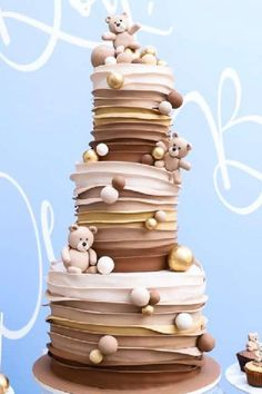 Take a look at the fabulous brown tiered ruffle cake decorated with fondant teddy bears and balls at this teddy bear baby shower! See more party ideas and share yours at CatchMyParty.com