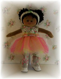 Lil Cherron has an Africa American skin tone. She loves to wear fancy smancy tutu dresses...