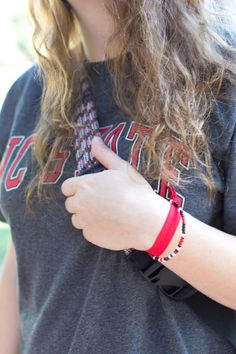 Add some school spirit to your hair or to your wrist with a set of creaseless hair ties in your favorite school colors!