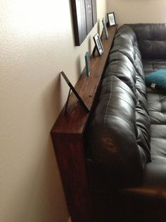 Long Narrow Sofa Table › Brown Wood Narrow Sofa Table Behind Black Leather Couch › Applying Chic Narrow Sofa Table behind the Sofa