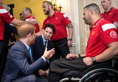 Prince Harry (L) meets with Canadian athletes as Prime Minister Justin Trudeau looks on during the Prince's visit to Toronto to promote the 2017 Invictus Games, which the city will be hosting, on May 2, 2016. REUTERS/Nathan Denette/Pool