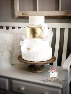 Gold and ivory wedding cake with wafer flower