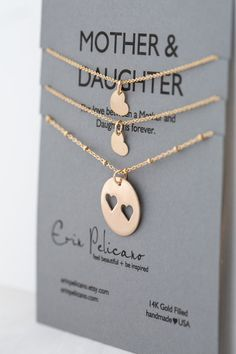 Mother Daughter Gift Jewelry Sets for Mom Mom and Daughter Sisters Necklaces Gift for Mom from Daughter Baptism Gift Mom Birthday Gift  - - - < < GOLD - MOTHER - DAUGHTERS - SET > > - - -   { { ITEM DETAILS } }  Jewelry Set celebrating Mama and her Girls  One Mother 18mm pendant, with heart cut out on an 18 gold filled beaded chain. Two heart charm necklaces with a delicate gold filled heart on a 16 or 18 chain.  The necklace is presented on a MOTHER & DAUGHTER card, The love ...