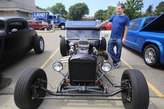 Sam Gion of Sterling Heights is admiring cars at the 2014 Woodward Dream Cruise along Woodward Ave. in Royal Oak.