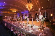 Luxurious and Elegant Wedding Reception Décor with Blush, Gold and Ivory Centerpieces, Tall Taper Candles and Long Feasting Tables at St Petersburg Fl Wedding Venue Vinoy Renaissance Sunset Ballroom | Gold Chiavari Chair Rentals by A Chair Affair | Tampa Wedding Photographer Limelight Photography