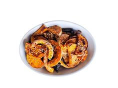 Chili-Sesame Butternut Squash : Roasting slices of butternut squash in a mixture of melted butter, fresh orange juice and apple cider vinegar creates irresistible spots of caramelization. Balance the sweetness with garlic, dried Mexican chile peppers and sesame seeds.