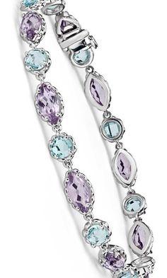 Elegant and colorful, this dazzling bracelet is comprised of blue topaz and amethyst gemstones framed in striking 14k white gold. #MothersDay