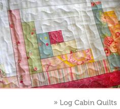 Log Cabin Quilt with modern fabrics. LOVE the quilting!!!