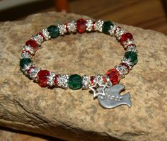 Christmas Hope Angel Bracelet made with red and green and silver Swarovski Crystal, silver plated red rhinestone spacers with a Dove of Peace and a small star charm. A beautiful way to show your Christmas spirit...and sparkle! Peace on Earth. OOAK