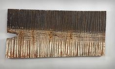 Textured panel by George Peterson Carved and painted oak, waxed linen 22 x 47 inches $2,800