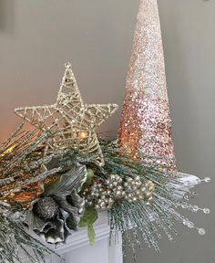 I incorporated a glittery cone tree atop my #Christmas mantel. To make your own grab some cardstock and create a few cone templates in different sizes. Reuse your templates to cut matching shapes from fabric or sparkly scrapbook paper and glue those on top of your cones. Wrap the shapes and glue in place to form a 3-D shape. Finish off by adding trim embellishments and cluster some on your mantel. You can cheat and buy styrofoam cones but what fun is that?  #mantelmonday #christmastree…