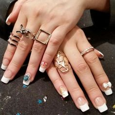 Turn a classic mani into an edgy Salon Acrylic French manicure with rococo art and luxe charms.