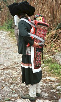 Side comb woman and baby wearing an embroidered hat and held in an embroidered baby carrier, Long Dong village, De Wo township, Longlin country, Guangxi province 0010d31.jpg