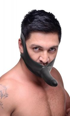Get up close and personal with the Face Fuk from the Master Series. This stretchy, all-latex strap on is designed to fit over the mouth or chin. You or your plaything can use it as a gag, or wear it on the chin which leaves the tongue free to roam as the dildo penetrates. The rigid black dildo is nice and stiff, with just enough give to the lifelike shaft. Comfortable and sturdy, the stretchy rubber straps run behind the head and beck, keeping it in place and stretching to fit most any size…