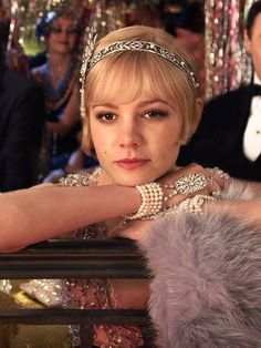 We adore the sparkly jewellery worn by Carey Mulligan, Imagine the horror of breaking a necklace from Tiffany...