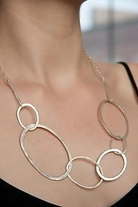 "Sterling silver necklace of forged links and chain. Hidden clasp in front can be hooked on any of the large ovals to create a ""Y"" necklace or a cluster formation, making this a versatile necklace for any neckline."